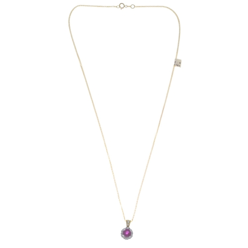 52 - An 18ct gold ruby and diamond pendant, suspended from an 18ct gold spiga-link chain.Estimated total ...