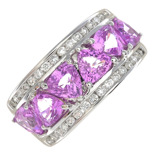 8 - An 18ct gold pink sapphire and diamond dress ring.Total pink sapphire calculated weight 3.21cts, bas...