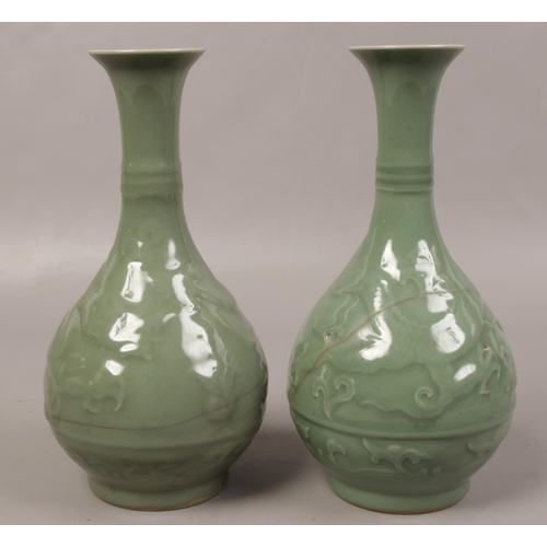1 - A pair of 19th century Chinese Celadon vases, decorated with dragons....