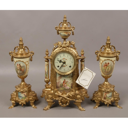 22 - A gilt metal Sevres style clock garniture, housing an 8 day movement striking on a bell....