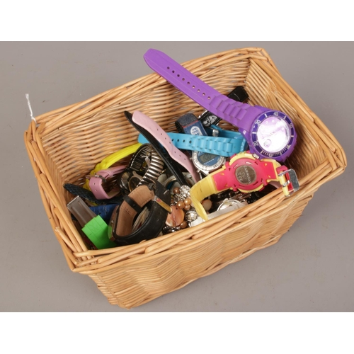 33 - A basket of quartz and manual wristwatches to include Sekonda, Lorus etc....