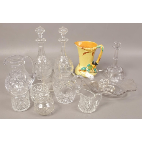41 - A collection of clear glassware to include Victorian decanters, cut glass jugs and a Burleigh jug....