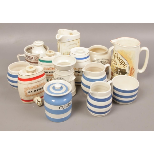 8 - A collection of ceramics to include Wade, Cornish ware advertising jugs etc....
