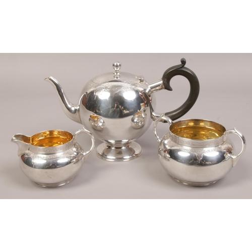 A Victorian silver three part tea set by Elkington & Co. assayed London 1898, gross weight 842 grams.