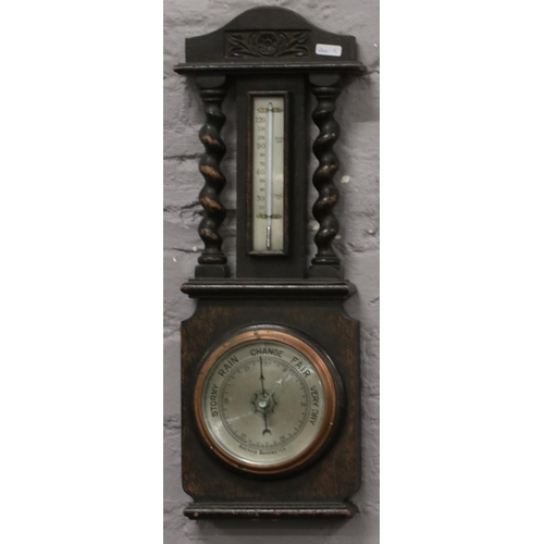 60 - An oak Aneroid wall barometer....