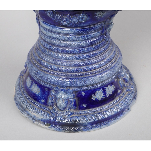 53 - A German Westerwald very large stoneware ewer. Blue glazed and moulded with Gothic strapwork and an ...