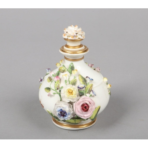 14 - A Rockingham bulbous scent bottle with ridged shoulder and flared neck. Embellished with gilt bands,...
