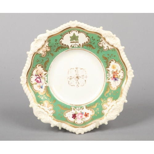 15 - A Rockingham armorial dessert plate with shell and gadroon moulding. Having green ground border with...