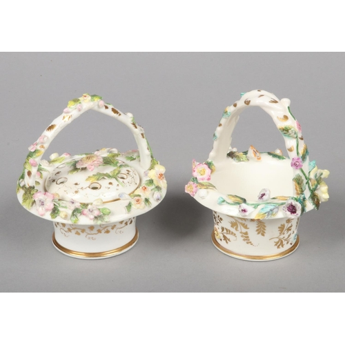 23 - A Rockingham pot-pourri basket with rustic handle and pierced cover and a similar basket. Both decor...