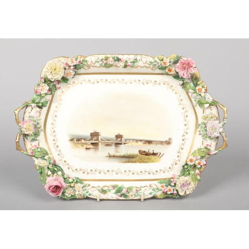 31 - A large Rockingham card tray with C-scroll moulding, delicate twig handles and applied Dresden flowe...