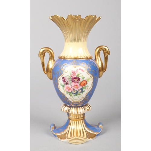 4 - A Rockingham stork-handled vase. Blue and yellow ground with gilt embellishments and a pair of gilt ...