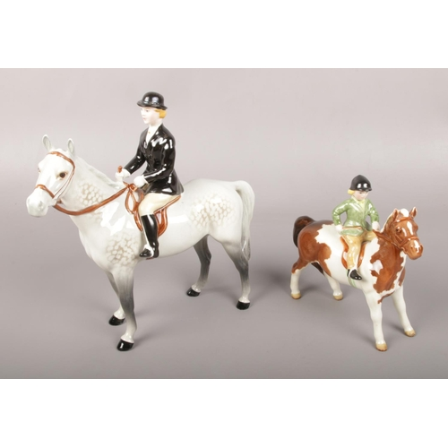 Two Beswick figures of horse riders to include child example.
