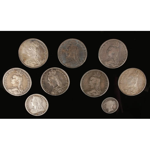 Victorian silver coins; seven crowns, half crown and one shilling.