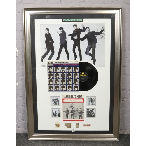 Autographs; The Beatles A Hard Day's Night framed display, with all four autographs and certificate of authenticity. (118cm x 78cm).