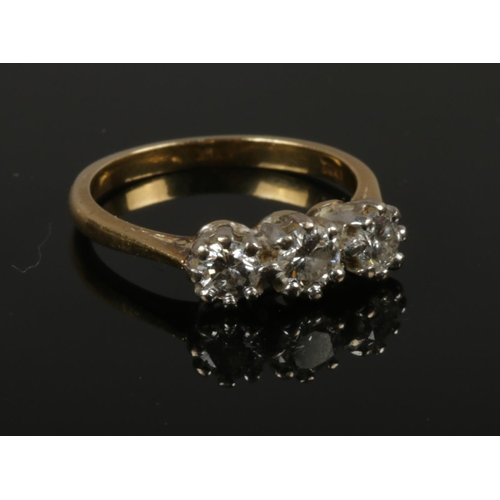 A 18ct gold 3 stone diamond ring, approximately 1 carat diamond, size N, gross weight 3.85g.