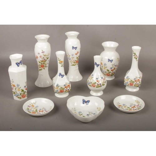 15 - A collection of Aynsley Bone China 'Cottage Garden', vases, pin dishes , candlesticks etc...