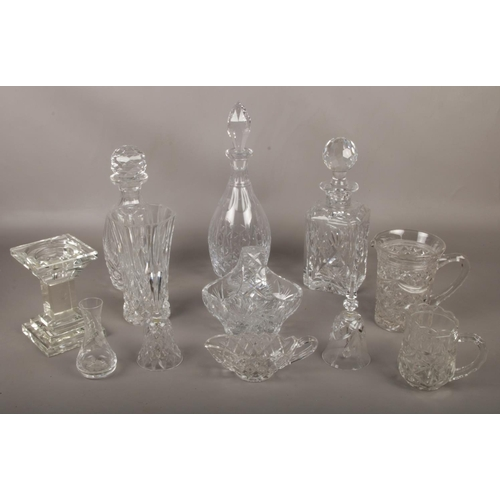 16 - A collection of cut crystal glass wares, Waterford & Edinburgh decanters, vases, candlesticks etc...
