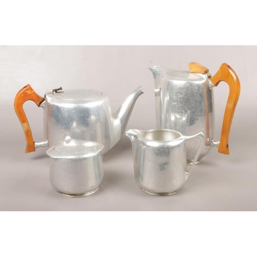 3 - A four piece Piquot ware teaset...