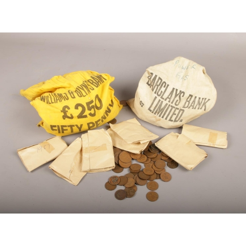 39 - Two bank money sacks, with contents of British pre decimal coins, mainly half pennies....