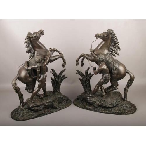 44 - After Coustou, A large pair of spelter Marly Horses. (Height 50cm)....