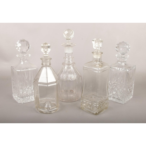 54 - Five glass decanters....