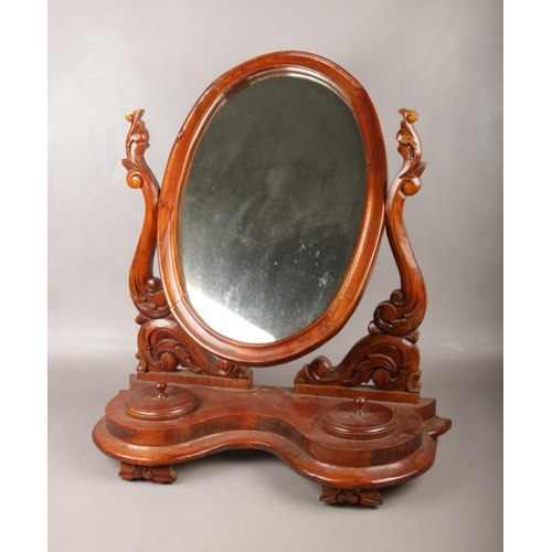 7 - A Victorian carved mahogany toilet mirror. (Height 72cm)....
