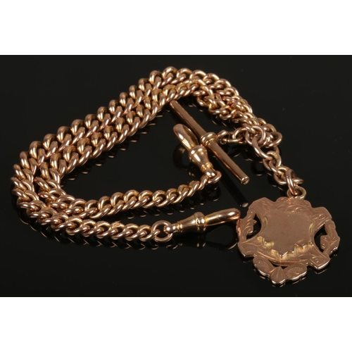 A 9ct gold fob on chain with T bar, 54.42g, 36cm long.
