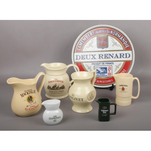 11 - A collection of ceramic advertising Whisky jugs, The Glenlivet, Tullamore Dew, The Original Mackinla...