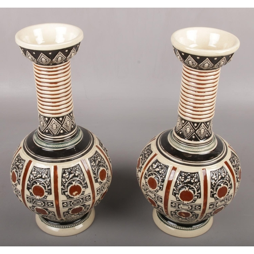23 - A pair of embossed vases, impressed mark to the base