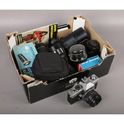 24 - A box of camera equipment to include Praktica camera, lenses etc....