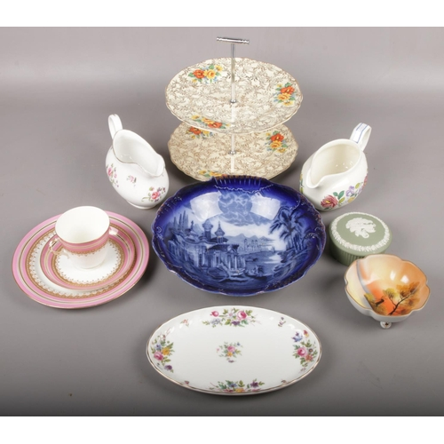 27 - A group lot of ceramics to include Royal Worchester trio, blue and white landscape printed plate, ca...