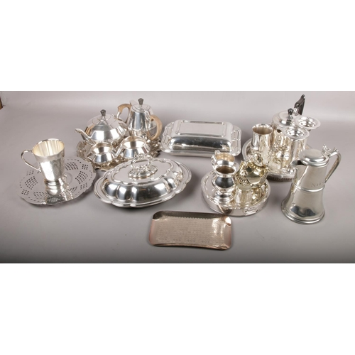 191 - A collection of silverplate to include 4 piece tea service, 3 trays, coffee pots, plate warmer, etc....