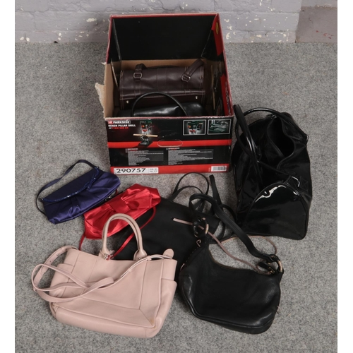 206 - A box of assorted handbags to include Radley etc....