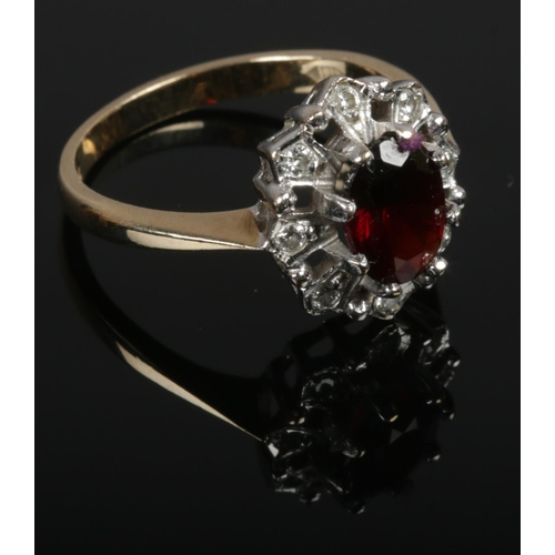 356 - A 9ct gold diamond and garnet ring, size O....