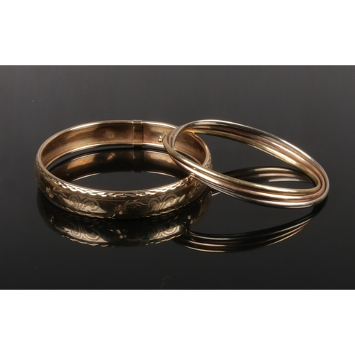 367 - A rose, yellow and white 9ct gold bangle along with another 9ct gold bangle. Combined weight 20 gram...