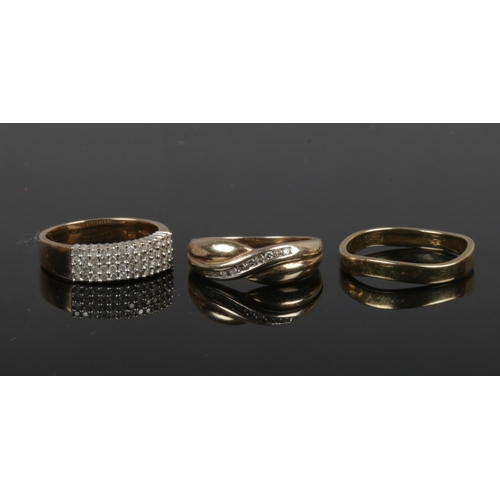 372 - Three 9ct gold rings. Including a plain band, a crossover band channel set with diamonds 0.15ct and ...