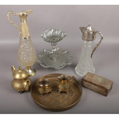 6 - A group lot of metalwares to include silver plate ballet dancer centrepiece, silverplate tray, trink...