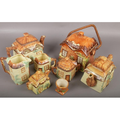 7 - A group lot of ceramic cottageware to include teapot, swing handle biscuit jar, jug etc....