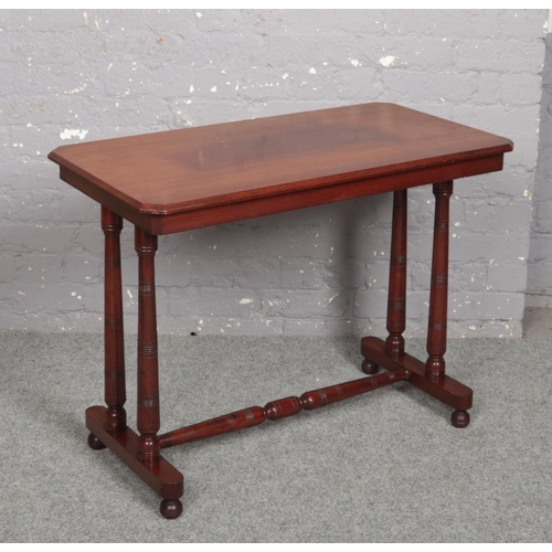 605 - A Victorian mahogany centre table raised on turned supports, 91cm x 50cm, 70cm high....