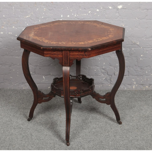 611 - A Victorian quarter veneered octagonal rosewood window table. With strung inlay, marquetry trailing ...