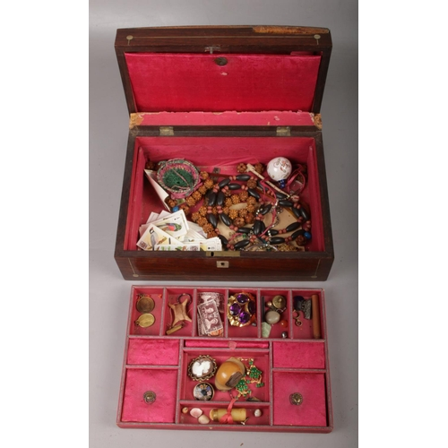 129 - A Victorian rosewood workbox (AF) containing haberdashery, costume jewellery and collectables etc....