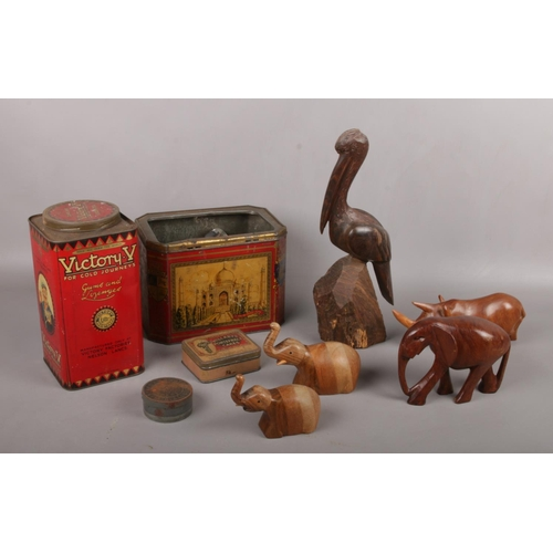25 - A group of vintage advertising tins, Victory V, Hillaby's Pontefract cakes examples to include woode...