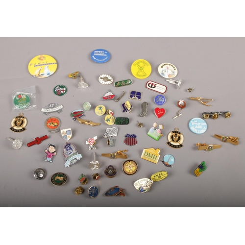 28 - A collection of badges, Pond Hopper Club 2000, National Blood service, Girl Guides examples...