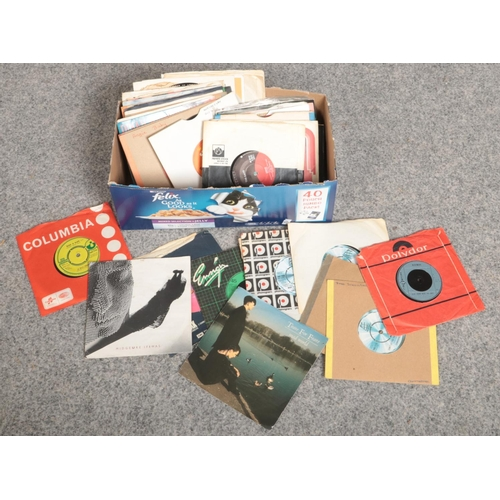 212 - A box of single records, to include Abba, Stevie Wonder, Midge Ure etc....