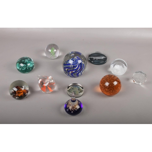 39 - A collection of paperweights, various colours and sizes...