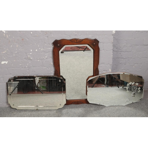 290 - An oak frame bevel edge wall mirror, along with two vintage mirrors....
