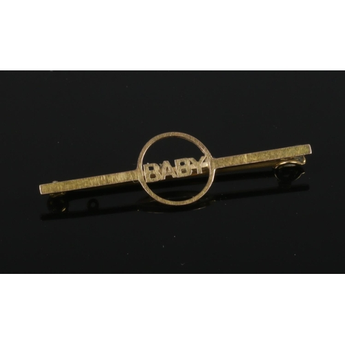 397 - A 9ct gold bar brooch inscribed Baby, 42mm wide....