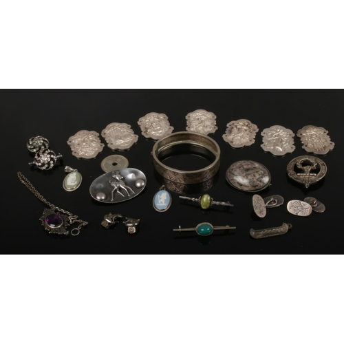 403 - A tray of white metal and silver items including connemara brooch, Wedgwood pendants, bangle and bel...