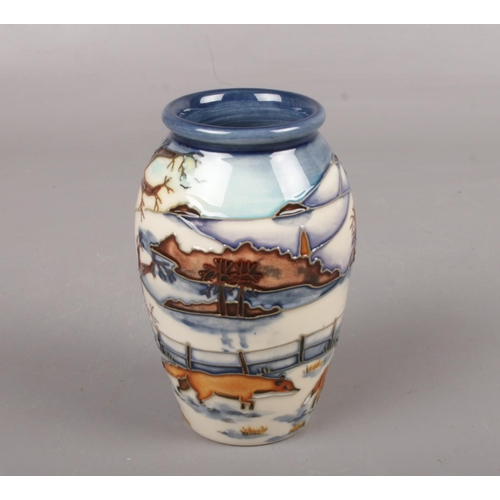 A Moorcroft pottery vase, 'Woodside farm' by Anji Davenport, approx 11 cm height with box