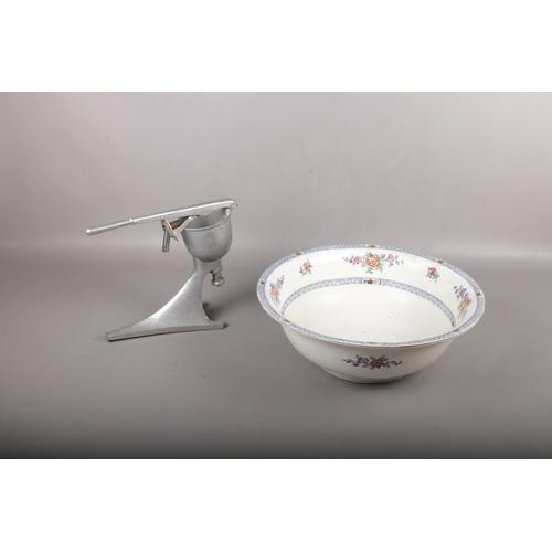 494 - A large ceramic Bowl and fruit press....